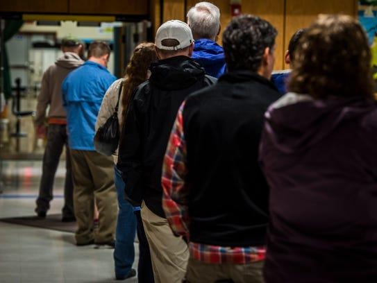 South Burlington voters line up outside the polling