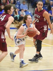 Mountain Home's Riley Walker passes out of a Beebe