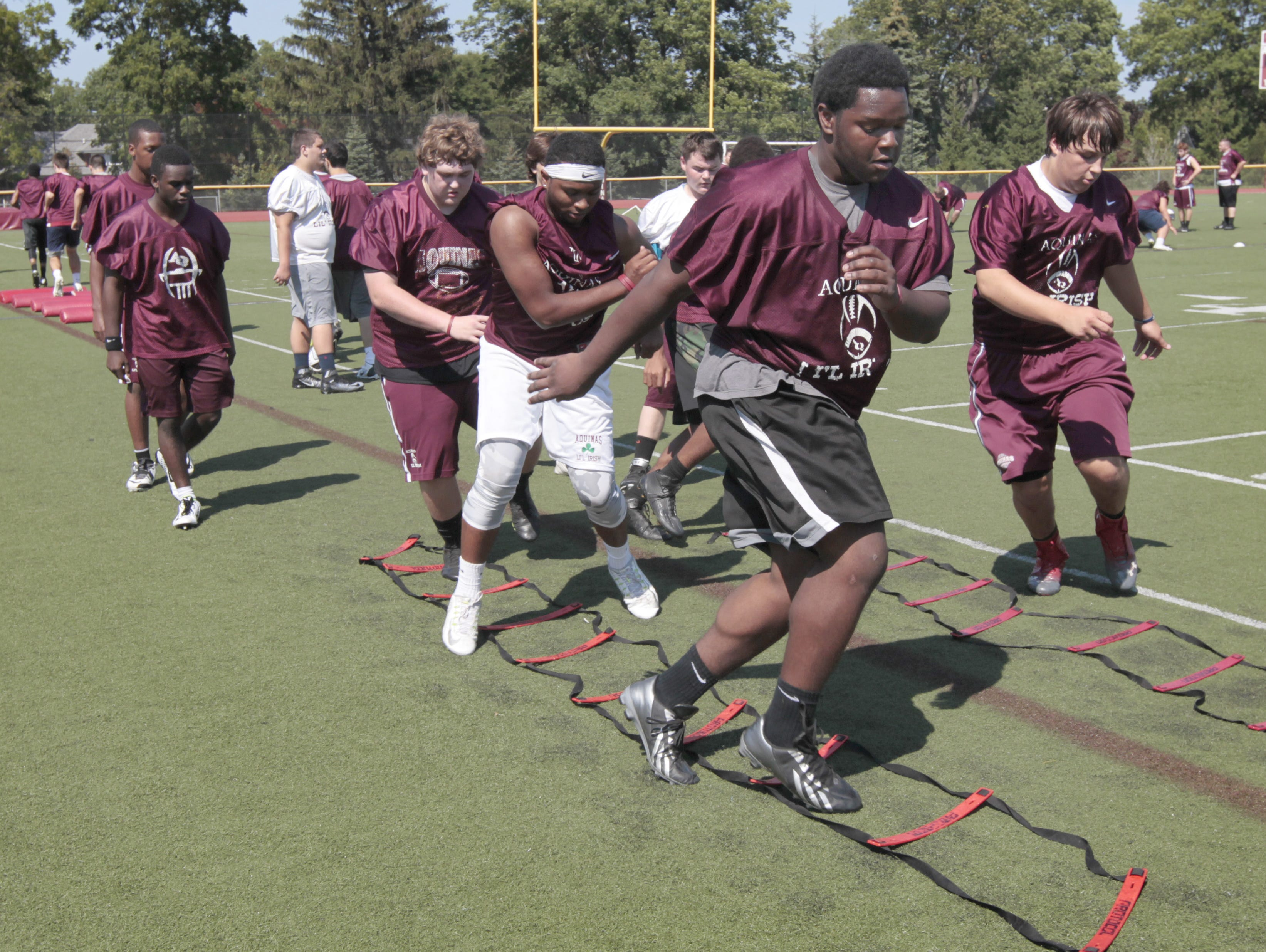 Offensive lineman Bishop Simmons (black shoes) - Class of 2016