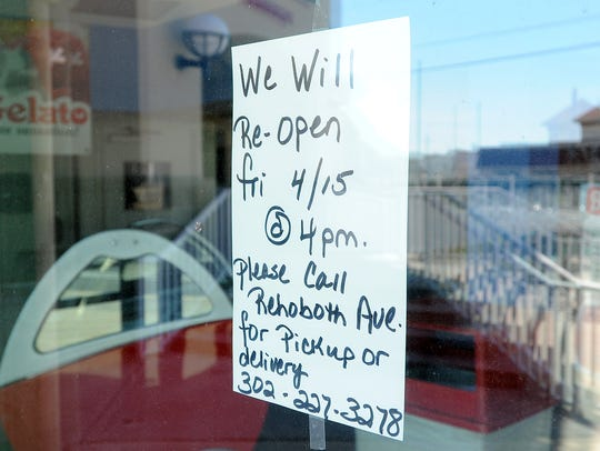 Grotto Pizza in Dewey Beach has a sign on the window