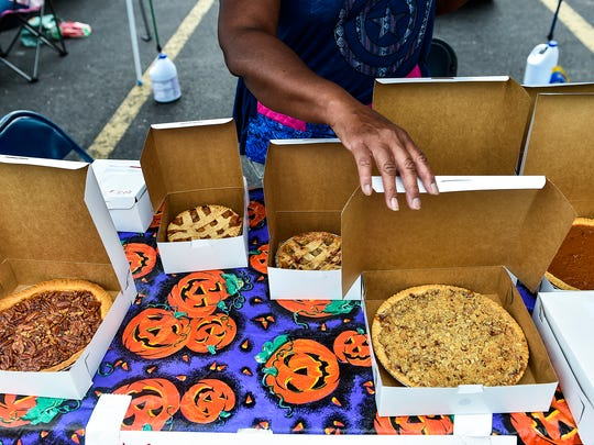 Fresh produce isn't the only thing for sale at the Downtown Marion Market. Here a local woman sells pies she made from scratch.