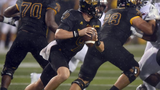Southern Mississippi quarterback Nick Mullens scrambles for extra room against Troy during an NCAA college football game Sept. 17 in Hattiesburg, Miss.