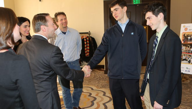 Robert Astorino, Westchester County Executive greets featured speakers Michael Guberti, 18, and his brother Marc Guberti, 17, from Eastchester, during the 2015 Youth Workforce Summit at the Crowne Plaza in White Plains last week.