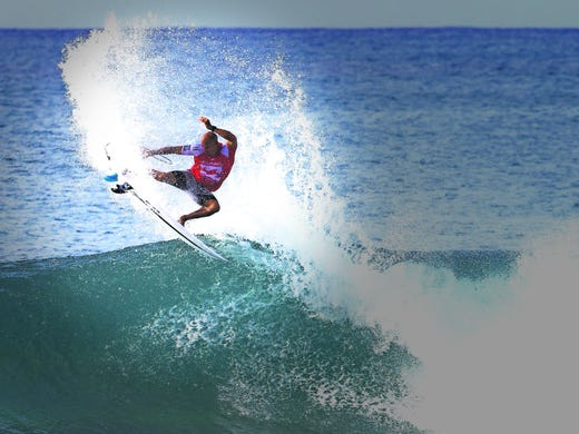 Kelly Slater takes part in the second day of competition