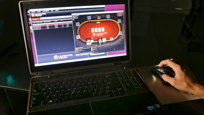 In this Monday, April 29, 2013, file photo, a sample poker game is played on the Ultimate Gaming website, in Las Vegas.