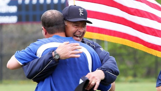 Eastchester baseball coach Dom Cecere hugs a former player during a ceremony at Eastchester High School May 10, 2014. Cecere was honored for 50 years of coaching baseball at Eastchester.