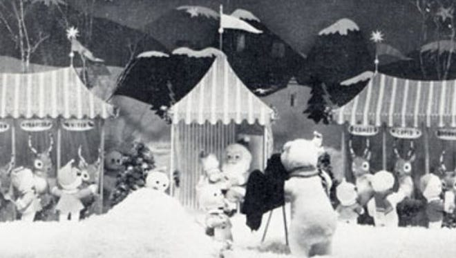 """From the December 1965 issue of the Knapp Sack, Knapp's newsletter Caption read """"Wonderland at Knapp's is our front window which portrays the annual visit to our favorite Santa. This mechanical window is a first at Knapp's and has awed many wee Lansingites (big ones too) as they stand and watch the characters move."""""""