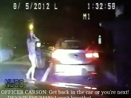 A still from the police dashcam video. Raritan Township Officer D.S. Carson orders Alexa Shuman back into her car as her father, off camera, cries that he can't breathe.