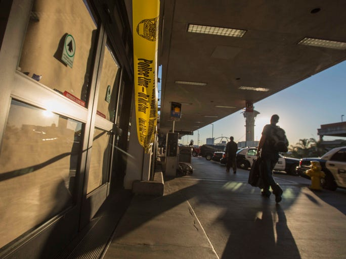 A part of LAX remains closed as departing passengers walk by on Saturday, Nov. 2, 2013.