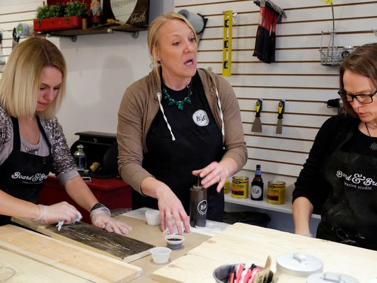 Kate Fitzgerald of Board and Brush Creative Studio, center, explains a process to participants at a workshop Thursday April 28, 2016 in Sheboygan.