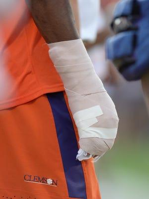 Clemson quarterback Deshaun Watson (4) hand was bandaged after injuring it in the 1st quarter Saturday, October 11, 2014 at Clemson's Memorial Stadium.