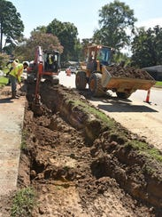Shreveport city workers use open trench sewer replacement