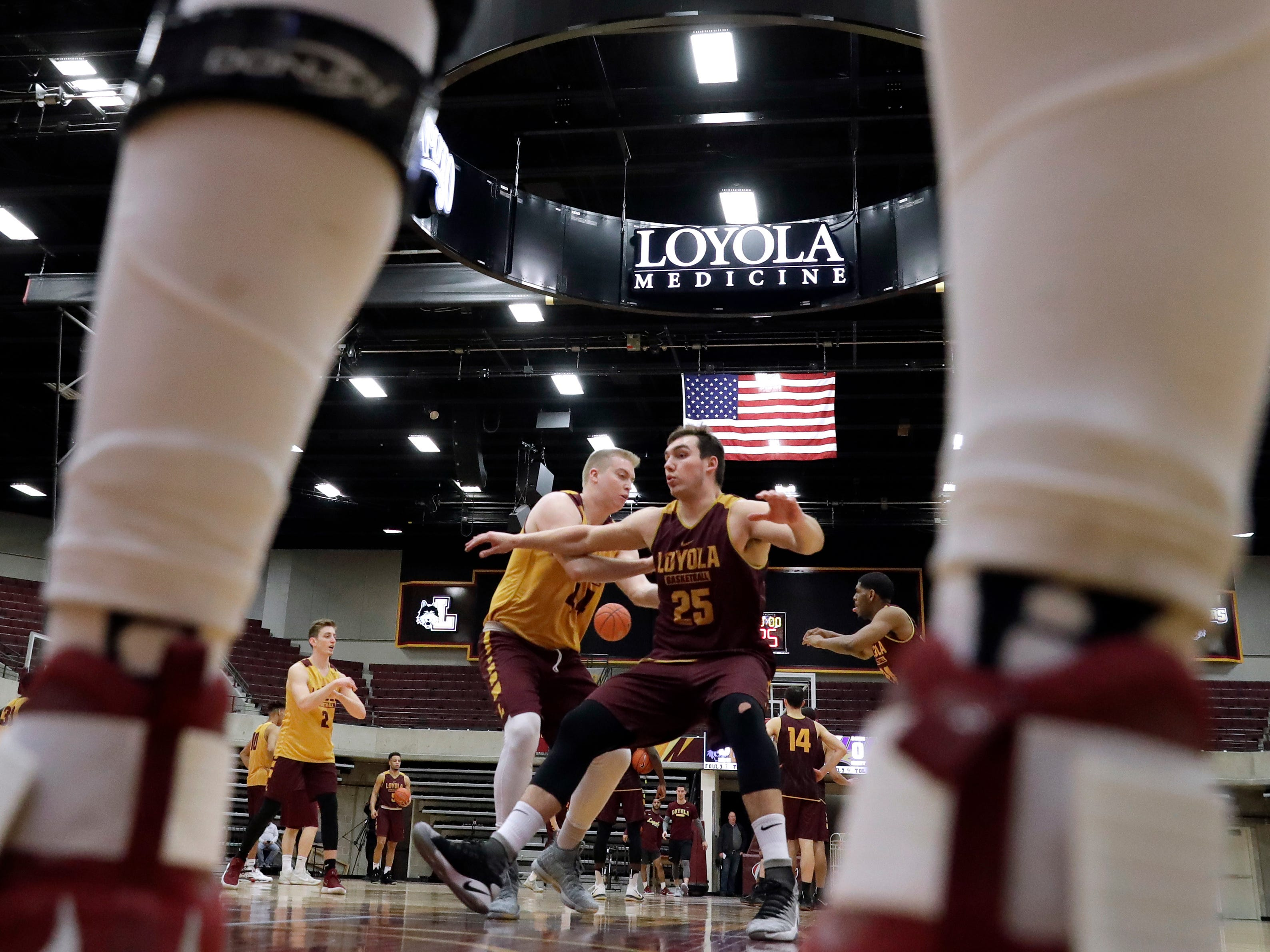 Loyola center Cameron Krutwig, right, works with forward Nick DiNardi during NCAA college basketball practice in Chicago, Friday, March 9, 2018. Loyola locks up 1st March Madness appearance in 33 years. (AP Photo/Nam Y. Huh)