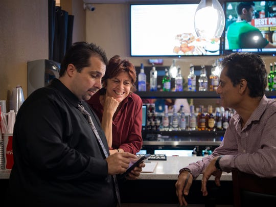 Bartender Dotty Scalco (center), of Port St. Lucie, chats with general manager Robert Healy (left), of Fort Pierce, and owner Bimal Dattani, of Orlando, at the new Touchstar Cinemas Sabal Palms Luxury 6 movie theater Aug. 17, 2017, at the Sabal Palm Plaza in Fort Pierce.