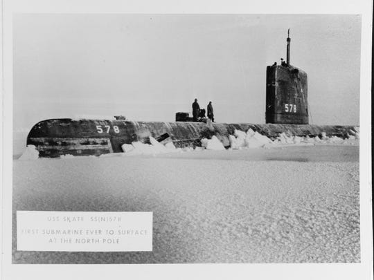 The USS Skate is surfaced at the North Pole on April 1, 1959. The Skate was the first submarine to surface through open water surrounded by ice.