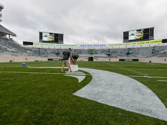 MSU Assistant Athletic Turf Managers Jared Knoodle,