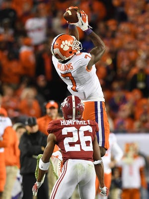 Clemson wide receiver Mike Williams (7) catches a pass over Alabama cornerback Marlon Humphrey (26) during the third quarter of the national championship game on Jan. 9.