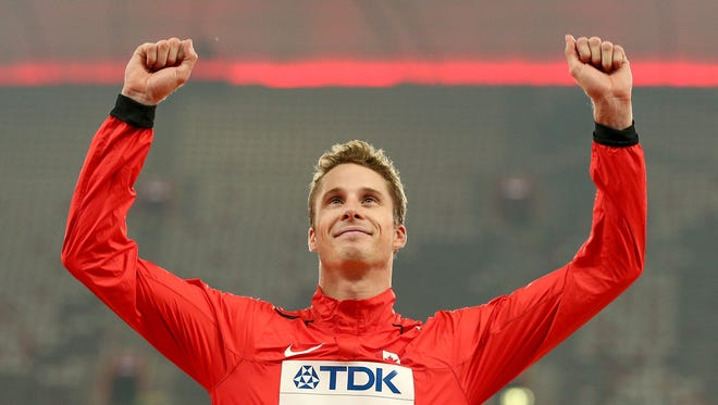 Gold medalist Derek Drouin of Canada poses on the podium during the medal ceremony for the Men's High Jump final during the 15th IAAF World Athletics Championships at Beijing National Stadium on Aug. 30, 2015.