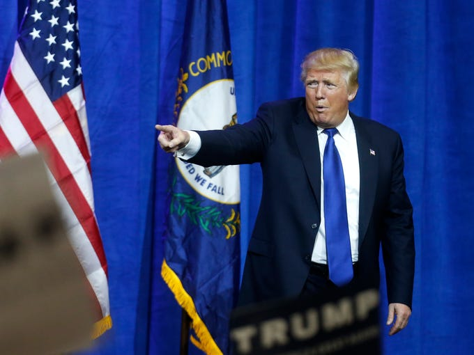 Donald Trump leaves the stage after speaking at a Rally