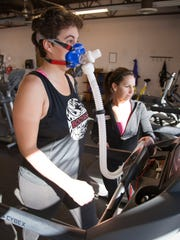 Spectrum audience analyst Casie Forbes measures her oxygen consumption through a VO2 machine at Movara March 4, 2016.