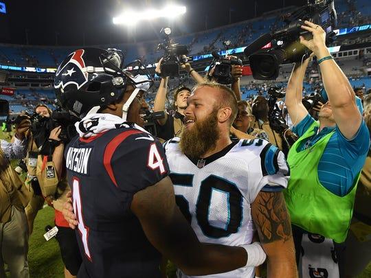 Houston quarterback Deshaun Watson, left, hugs former Clemson teammate Carolina Panthers linebacker Ben Boulware after their preseason game at Bank of America Stadium on Wednesday, August 9, 2017.