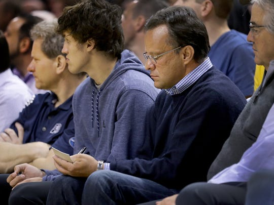 Former Indiana University men's basketball coach Tom Crean takes notes as he sits court side at the Pacers game against the Cleveland Cavaliers Sunday, April 23, 2017, afternoon at Bankers Life Fieldhouse.