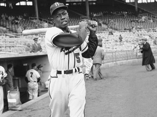 Hank Aaron loosens up in 1954 as a rookie outfielder for the Milwaukee Braves. Aaron returned to Milwaukee to play for the Brewers.