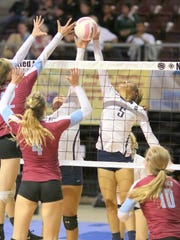 Silver's Kim Renteria battles at the net against Sandia