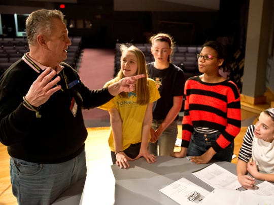 """Sean Moran works with students at Williston Central School during a rehearsal for their up coming performance of """"Grease"""" that opens in April."""