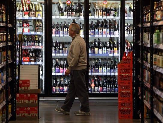 The aisles are filled with different types of beer