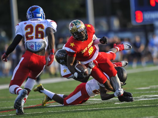 Ashante Worthy of Freehold, runs with the ball in the North-South Football Classic at Kean University in Union on June 26, 2018.