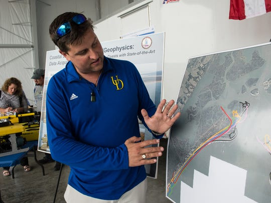 University of Delaware Marine Science professor Art Trembanis explains how the shoreline has changed on Wallops Island using a map at Wallops Flight Facility on Friday, Sept. 22, 2017.