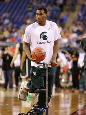 Michigan State's Javon Bess looks on during a practice session for the NCAA Final Four tournament college basketball semifinal game Friday, April 3, 2015, in Indianapolis.