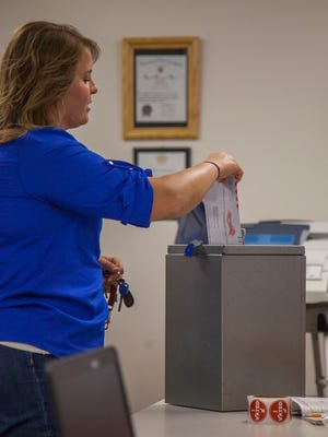 An Iron County resident drops off a ballot at the Enoch City Offices, Tuesday, June 28, 2016.