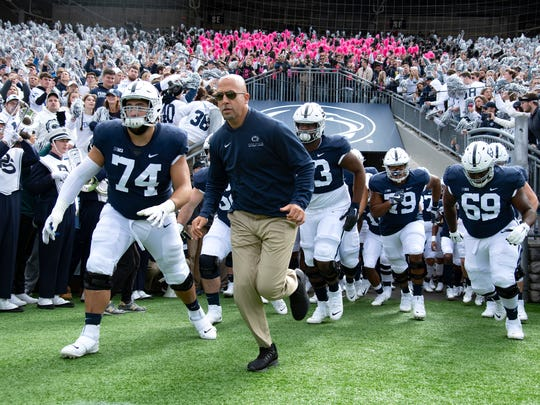 FILE - In this Oct. 5, 2019, file photo, Penn State head coach James Franklin leads his team onto the field for their NCAA college football game against Purdue, in State College, Pa. Penn State (8-0) plays against Minnesota (8-0)  on Saturday, Nov. 9. (AP Photo/Barry Reeger, File)