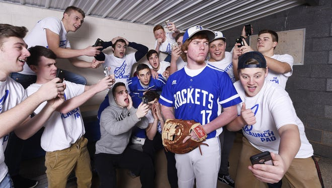 Spring Grove's Austin Piety spent most of the year leading his school's student section cheering on classmates. In the spring, he took the field playing first base for the Spring Grove baseball team. Here, Piety posed in the dugout with the Spring Grove student section during a photo shoot for the GameTimePA.com spring sports season preview.