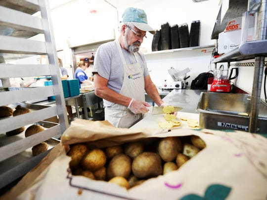 Community Cooperative Ministries volunteer, John Smith scallops potatoes. He and his wife, Carloyn are long time volunteers at the soup kitchen and in their community. The Community Cooperative Ministries in Fort Myers is participating in the 2019 USA TODAY NETWORK Gannett Foundation A Community Thrives fund-raising initiative.