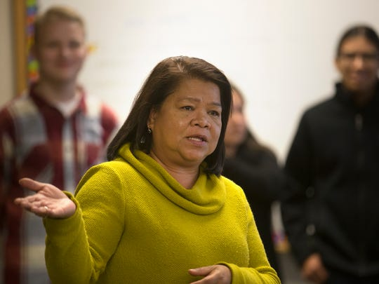 Science teacher Yolanda Flores talks about her students' research projects on Thursday at Navajo Preparatory School in Farmington.
