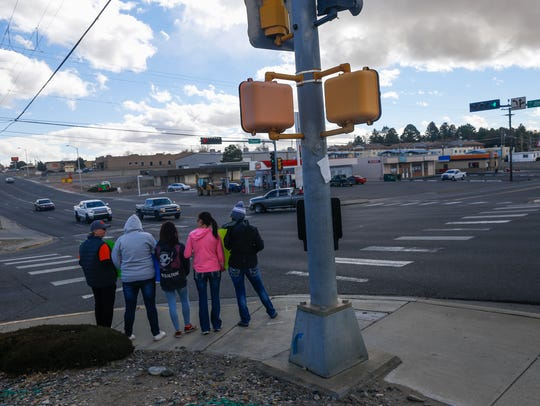 Several protesters stand on the corner of 20th Street and North Dustin Avenue in Farmington on Monday to bring attention to ending gun free zones and call for allowing teachers to carry concealed weapons in schools.