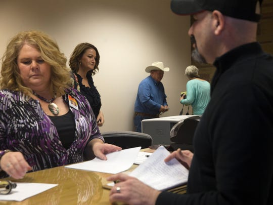 San Juan County Clerk Tanya Shelby, left, and members of her staff process paperwork during a candidate filing day on Tuesday, March 13, 2018 in at the San Juan County Clerk's office in Aztec.