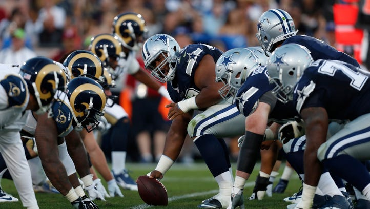Dallas Cowboys center Joe Looney prepares to hike the ball in the second half of a preseason NFL football game against the Los Angeles Rams, Saturday, Aug. 13, 2016, in Los Angeles.