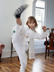 Makayla Zavrl, 9, demonstrates her karate skills in