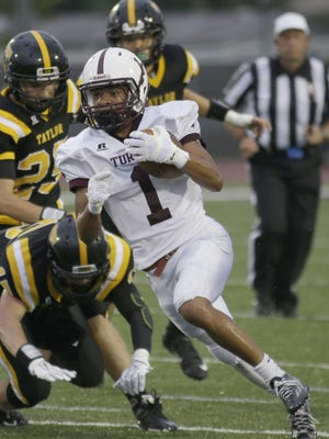 Turpin's  Adrian Baker runs the ball for the Spartans  during a  football game against Taylor Friday, Sept. 11.