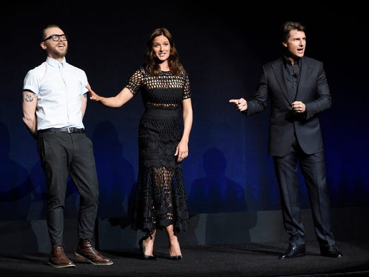 """Tom Cruise, right, star of the upcoming film """"Mission:"""