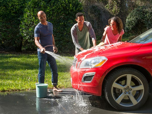 Family wash car at home fun together