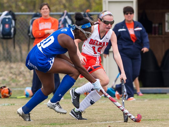 Delmar's No. 19 Hailey Bitters competes for possession with Dover's No. 10 Frances Blake during a DIAA playoff game in Delmar.