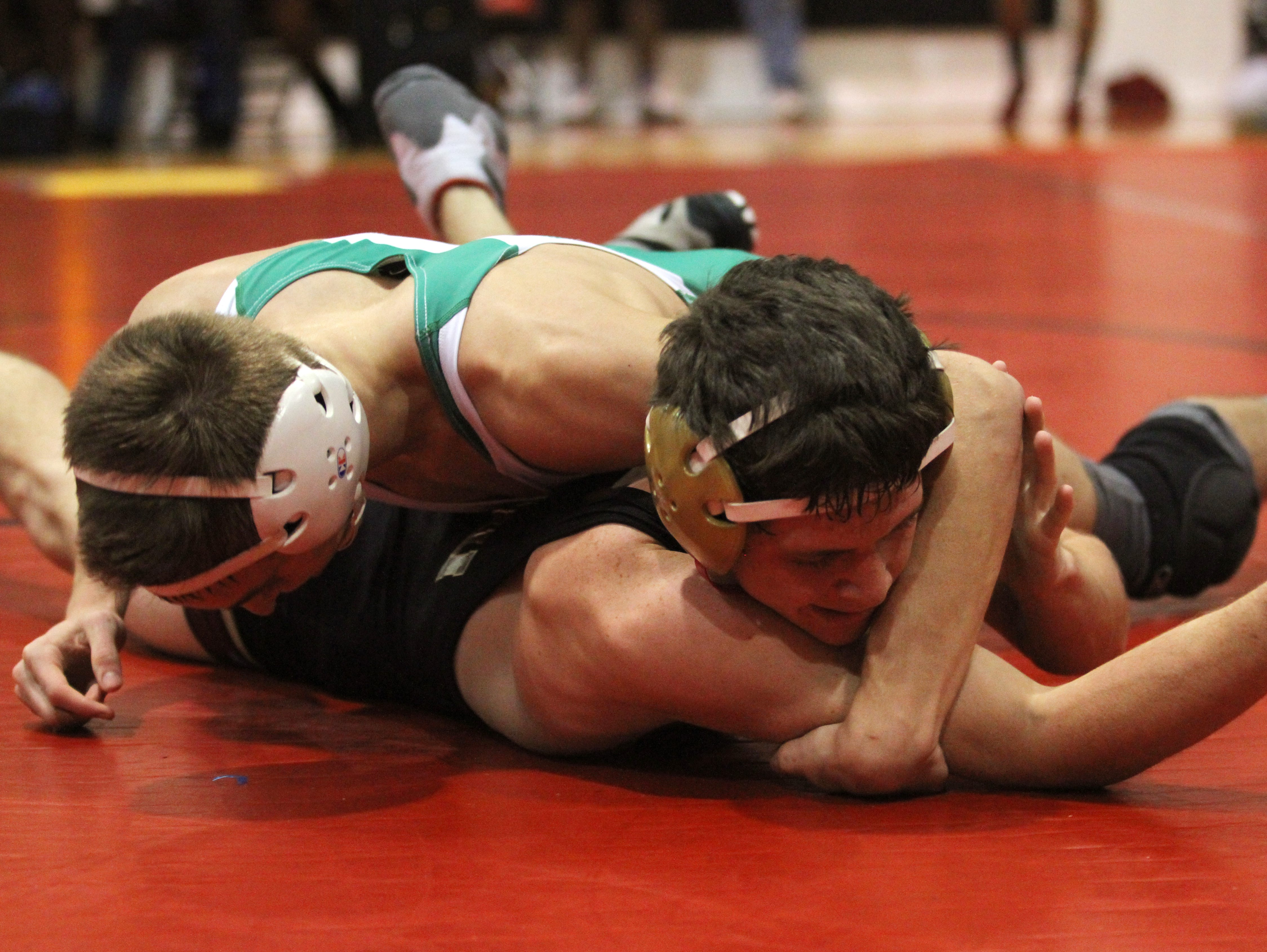 Jarret Chandler of Riverdale and Colten Thomas of Fort Myers wrestle on Friday in the District 2A-11 Wrestling Championships at North Fort Myers High School.