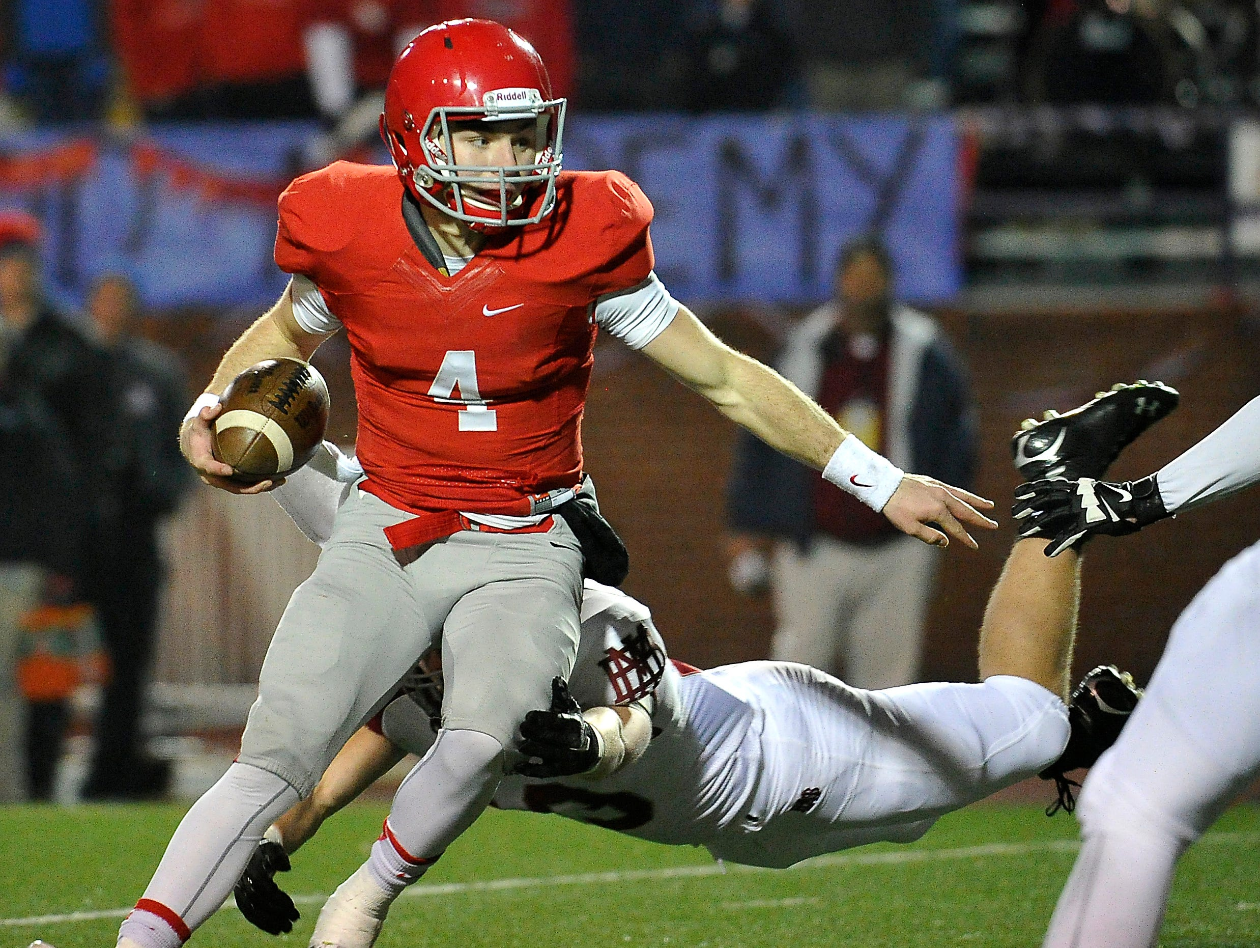 Brentwood Academy's Jeremiah Oatsvall scrambles in the DII-AA state title game. Oatsvall was named offensive MVP, completing 17 of 29 pass attempts for 280 yards and gaining 159 yards rushing and two scores on 23 carries.
