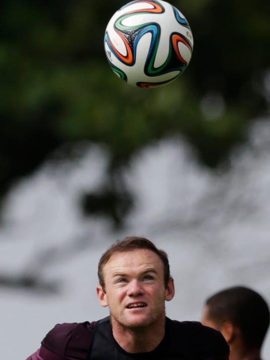 England national soccer team player Wayne Rooney heads a ball during a squad training session for the 2014 soccer World Cup at the Urca military base in Rio de Janeiro, Brazil, Wednesday, June 11, 2014.  The England soccer team are staying in Rio de Janeiro as their base city for the 2014 soccer World Cup.  (AP Photo/Matt Dunham)