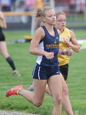 Jenna Barker of Seton Catholic runs in the 800 meters during the IHSAA track and field regional Tuesday at Shelbyville.